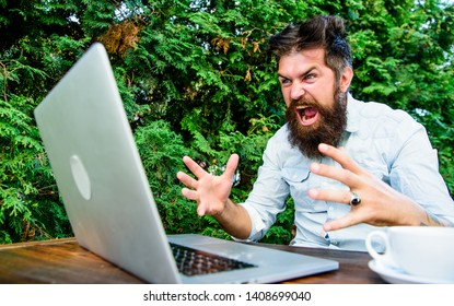 Remote job. Freelance professional occupation. Hipster busy with freelance. Wifi and laptop. Slow internet irritating. Drink coffee and work faster. Deadline is coming. Bearded man freelance worker.