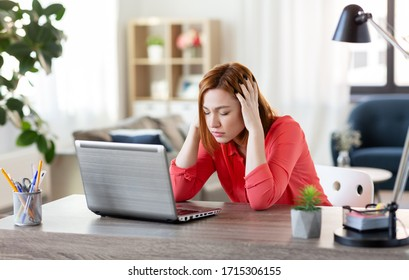remote job, technology and people concept - stressed young woman with laptop computer working at home office