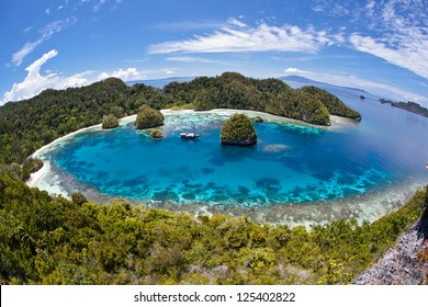 A remote lagoon, surrounded by limestone islands, protects a vibrant and diverse coral reef in Raja Ampat, Indonesia.  This is one of the most diverse areas on Earth for marine life.