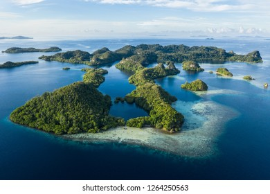 "Remote limestone islands in Raja Ampat, Indonesia, are surrounded by healthy coral reefs. This biodiverse region is known as the ""heart of the Coral Triangle"" due to its amazing marine life."