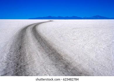 Remote road through Salar de Uyuni in Bolivia