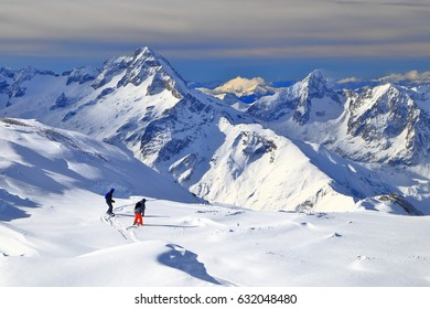 Remote skiers on off piste track in Les Deux Alpes, France