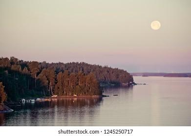 Remote Swedish Coastline with Moon