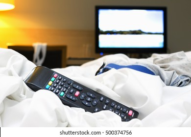 remote tv control on hotel bed  dangerous  for infection by bacteria