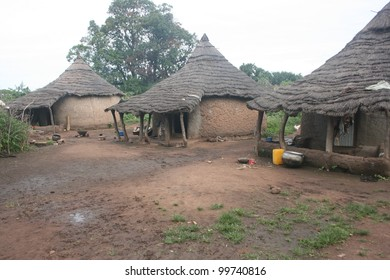 a remote village of the Gaan people of Burkina Faso, Africa, homes made from mud with thatched roofs.