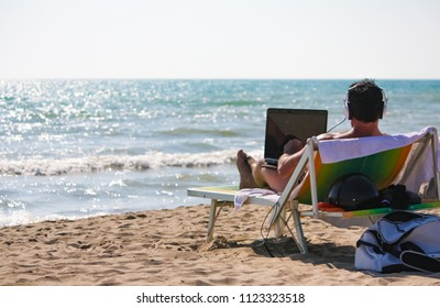 Remote Working Concept - Man at work from the beach