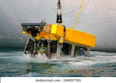 Remotely operated underwater vehicle (ROV) lifting on board of Russian carrier vessel after the working in ocean abyss