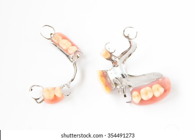 removable partial denture on white background.