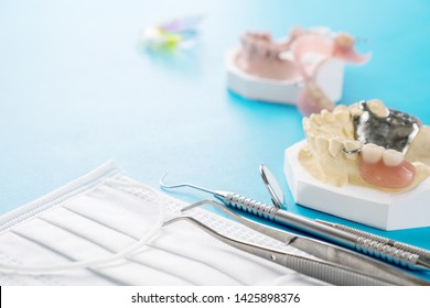Removable partial denture (RPD.) on blue background.