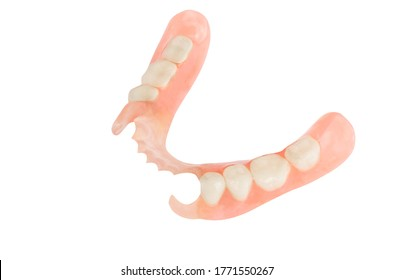 Removable plastic partial denture on white background