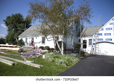Removal of Aluminum Siding in preparation for new vinyl siding on cape cod home