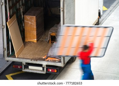 removal truck and delivery man