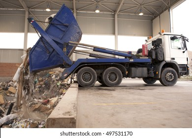 Removal of waste to the incinerator, truck dumps waste