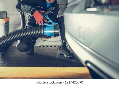 Removing Car Pollution While Maintenance Inside the Auto Service Building. Automotive Equipment.