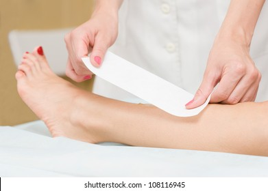 Removing hair from woman leg