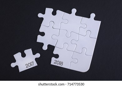 Removing the last jigsaw puzzle piece with word 2017 2018.