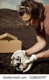 Removing of skull from place of find on summer terrain excavations on field location