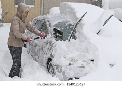 Removing snow from car window