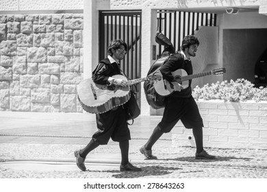 RENACA, CHILE - NOV 6, 2014:  Unidentified Chilean local musicians with guitar in Renaca. Chilean people are of mixed Spanish and Amerindian descent