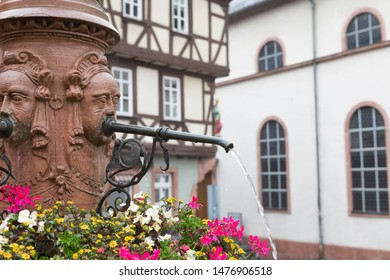 "Renaissance 16th century fountain ""market fountain"" or  ""Marktbrunnen fountain"" spraying clear water at the inner city of Miltenberg, Germany"