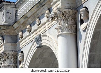 Renaissance bas-reliefs, ornaments and statues busts of the Palazzo della Loggia in Brescia