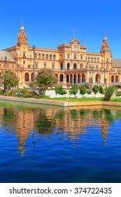 Renaissance building surrounded by water in Plaza de Espana (Spain Square) in Seville, Andalusia, Spain