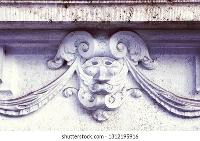 Renaissance facade decoration, carved marble mask under the ledge of an antique palace