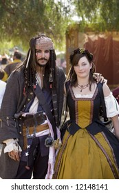 Renaissance Pleasure Faire, Irwindale, CA 4-26-08:  A man dressed as a pirate captain with a lady.