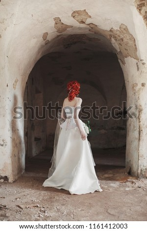bfe9de44696 Renaissance redhead mysterious princess with hairstyle in old castle. Doll  in corset. Victorian princess in palace. Fabulous mysterious phantom in  white ...