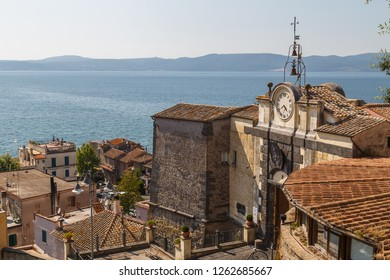Renaissance town gate with clock in Anguillara Sabazia, Italy