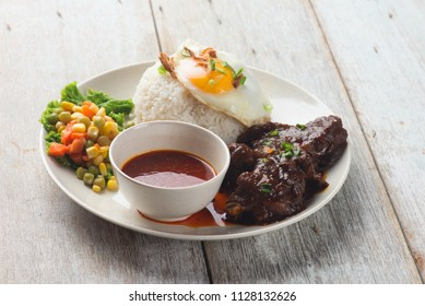 RENDANG DAGING with wood background