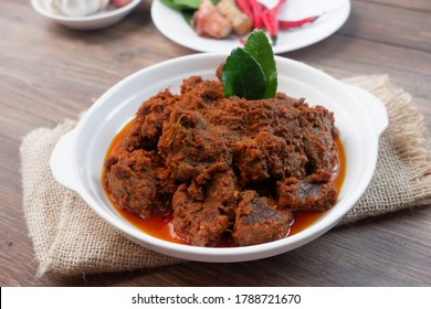 Rendang is an Indonesian West Sumatra Minangkabau spicy meat (commonly beef) that slow cooked in coconut milk and mixed spices, served during festive events like wedding, Eid Al Fitr and Eid Al Adha