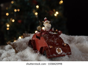 Rendeer riding a red car
