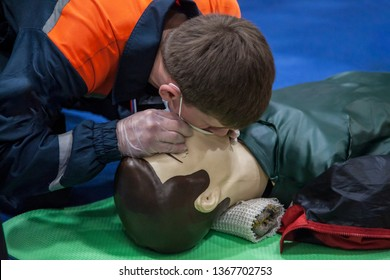 rendering man doing artificial respiration, lifeguard makes mouth-to-mouth breathing