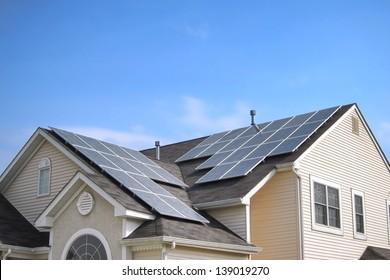 Wonderful Renewable Clean Green Energy Saving Efficient Photovoltaic Solar Panels On  Multiple Gable Suburban House Roof Over