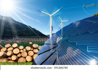 Renewable energies sources - Wind energy (wind turbines),  solar energy (solar panels), biomass (tree trunks) and hydro power (dam for hydroelectric power)