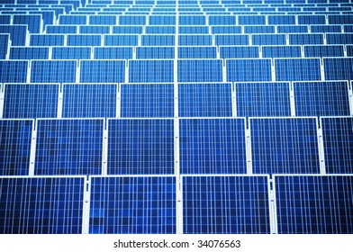 Renewable energy - arranged solar panels. Focus on front.