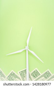 Renewable Energy Concept. Windmill on green paper. Copy space.