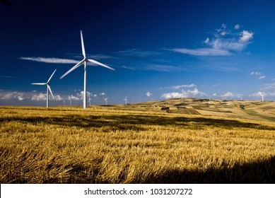 renewable energy and environmental impact. Countryside with wind generators