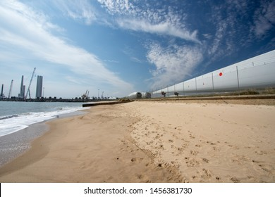 Renewable energy production and development. Offshore wind farm turbine construction. Investment in the renewable power industry. Massive blade and tower parts