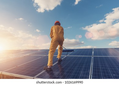 Renewable energy and solar power concept, worker or Electrical engineers are checking, installing or cleaning photovoltaic plant in solar power station alternative energy from nature