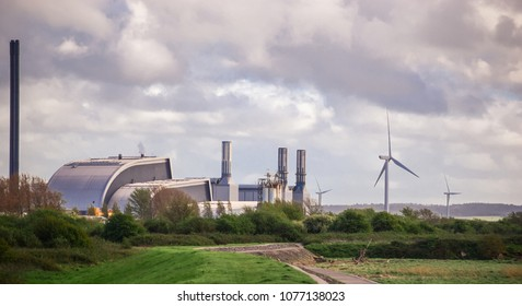 renewable power plant next to wind turbine