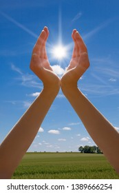 Renewable solar energy symbol with hand and sun