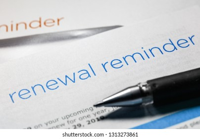 renewal reminder business letter and a pen