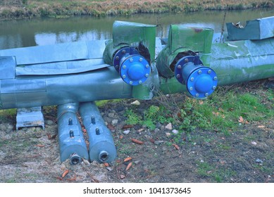 Renewal steam heating pipelines with ball valve.  The pipes in the exterior, city buildings in background