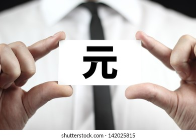 Renminbi, Chinese Yuan symbol. Businessman in white shirt with a black tie, shows business card.