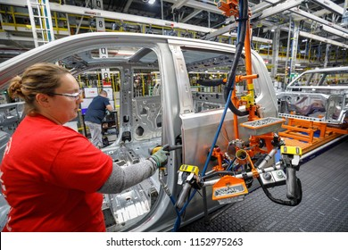 Rennae LaPan attaches a steel and aluminum door at GM's Chevrolet Silverado and GMC Sierra pickup truck plant in Fort Wayne, Indiana, U.S., July 25, 2018. Picture taken on July 25, 2018.