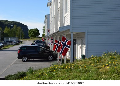 Rennesoy, Rogaland / Norway - May 17 2019: Street of the Norwegian village on the eve of the celebration of the Norwegian Constitution Day.
