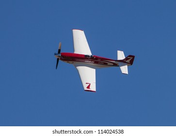 RENO, NEVADA - SEPTEMBER 15: Steven Hinton pilots the P-51D Mustang called Strega during Gold 3A Unlimited Heat race at the National Championship Air Races on September 15, 2012 near Reno, Nevada.