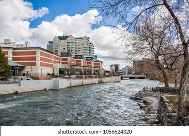 Reno, Nevada skyline as seen from the shoreline of Truckee river flowing through downtown